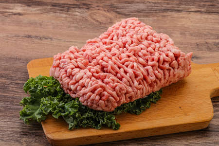 Raw pork minced meat with spices for cooking