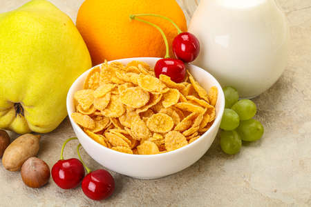 Breakfast with corn flakes, fruits and milk Banco de Imagens