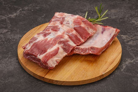 Raw pork ribs served rosemary for cooking