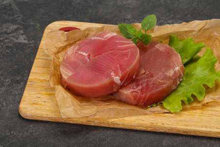 Raw tuna round steak ready for grill