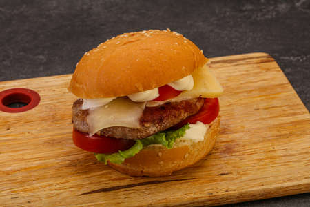 Delicous burger with tuna fish and cheese