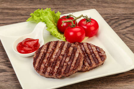 Grilled burger cutlet with tomato sauce