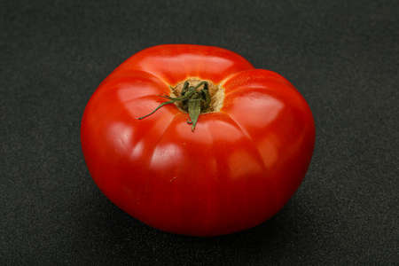 Ripe big juicy red tomato for cooking
