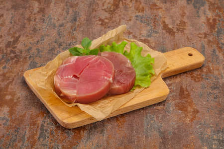 Raw tuna round steak ready for grill