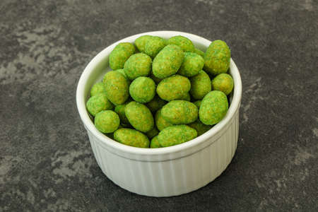 Spicy wasabi peanuts snack in the bowl