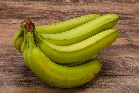 Green sweet tasty banana heap isolated Reklamní fotografie