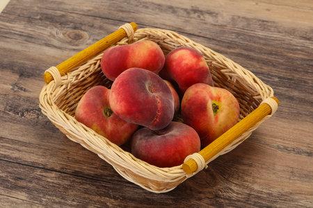 Sweet ripe tasty few flat peaches