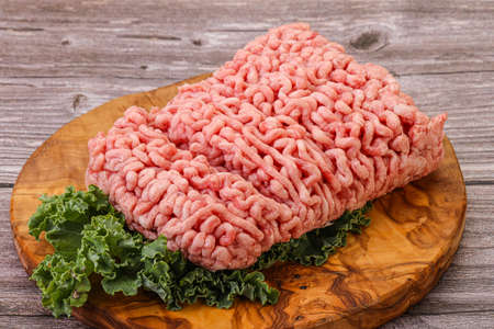 Raw pork minced meat with spices for cooking Stock Photo
