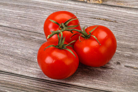 Red bright ripe and sweet tomato branch