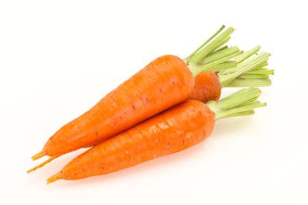 Three Young fresh ripe carrots