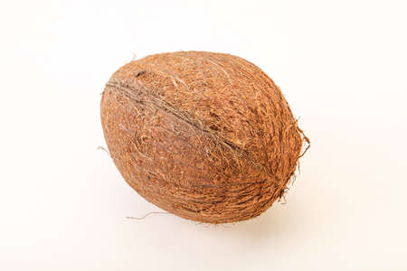 Tropical brown coconut over background isolated