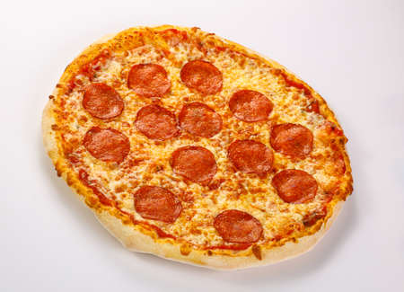 Italian traditional Pizza with pepperoni sausages