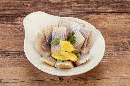 Marinated Herring fillet with sliced lemon