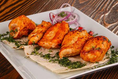 Chicken kebab shashlik served salad adn rosemary