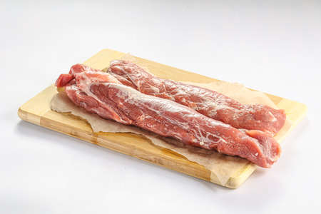 Raw pork tenderloin over board isolated Stockfoto
