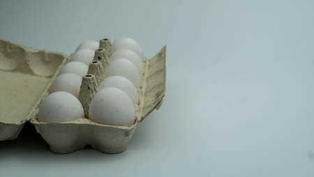 Many white eggs in the tray. Organic egg pack isolated background.
