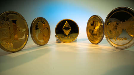 Gold coin Etherium ETH in the middle and another coins Litecoin, Ripple, ZCash on the side. Mining. Popular crypto coins for trading.