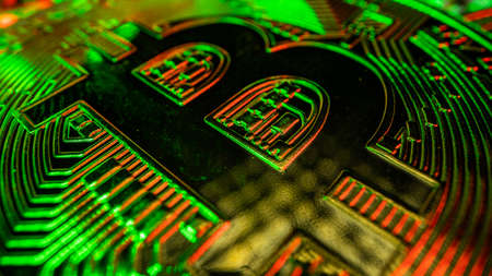 Super macro shot of Bitcoin with green and red light. Blockchain technology. Curency of future Stockfoto