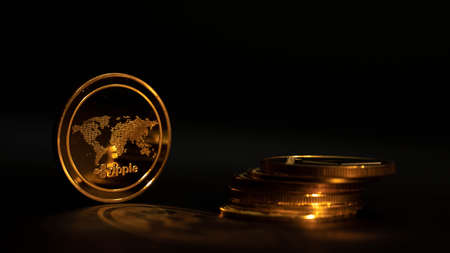 Crypto coin Ripple XRP in black background with another coins. Gold light. Stockfoto