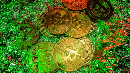 Many gold Bitcoins with green light. Top view angle. Halving. BTC. Gold coins on the table. Trading on crypto market
