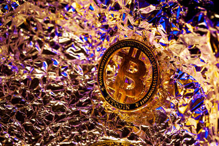 Bitcoin on surface with neon and gold reflections. Currency of the future. Halving. Money. Coin. Mining Archivio Fotografico - 149828872