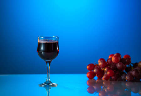 Glass of wine on a beautiful blue background. holiday mood