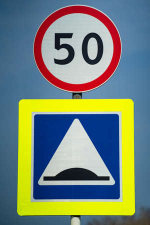 road sign for roughness on the road. close up shot. road sign speed limit 50 km pes hour