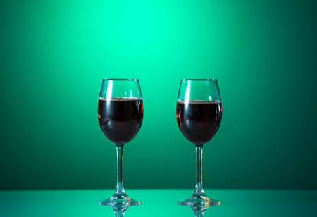 Red wine in the glass on the table. reflected glass. Summer mood Archivio Fotografico
