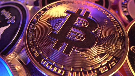 Macro Bitcoin BTC with gold and blue neon light with many reflections. Halving. Mining. Cryptocurrency. Money of the future