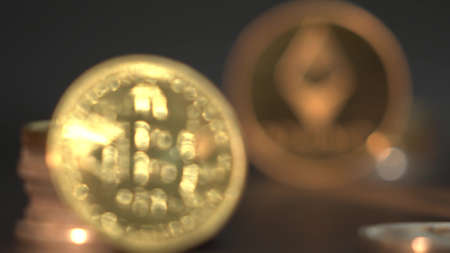 Two gold crypto coins Bitcoin BTC and Etherium ETH surrounded by many other crypto currency. Black gradient background. Archivio Fotografico