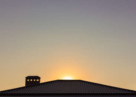 dawning: Sunset over the house Stock Photo