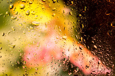 reflectivity: bright abstract background of water drops on glass