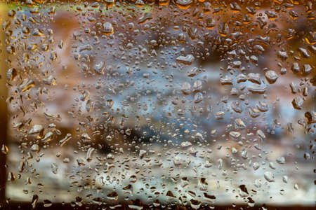 sodden: bright abstract background of water drops on glass