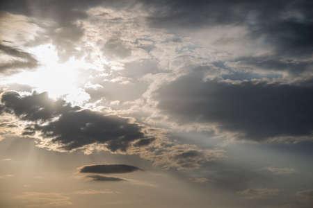 sun lit: bright sun lit the clouds in the sky