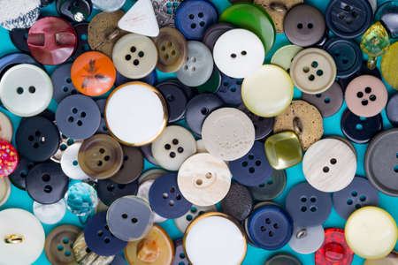orifice: the background of a large number of buttons closeup