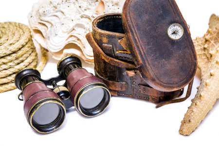 Antique binoculars with leather case , rope and  star fish  isolated on white photo