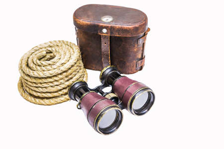 antique binoculars: Antique binoculars with rope and leather case  isolated on white