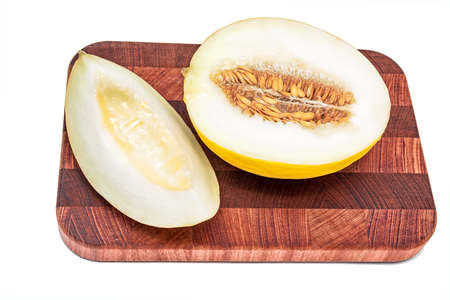HONEYDEW: Honeydew melon on cutting board  isolated over white background