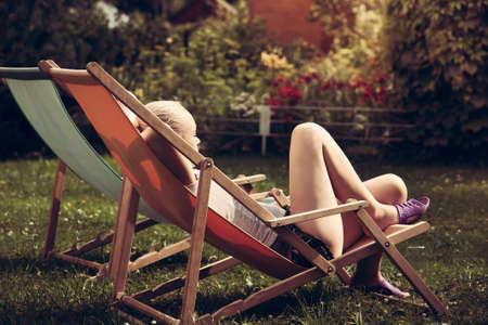woman relax: Young woman relax outdoors in chaise longue
