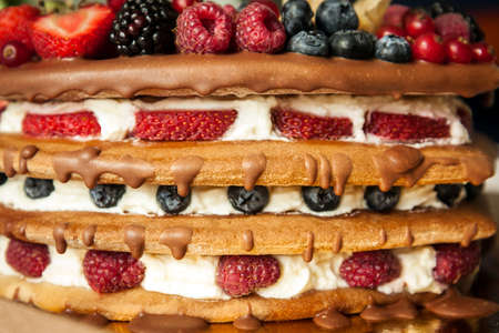 layer cake: Chocolate topped sponge layer cake with berries