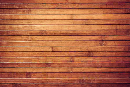 old wood: Horizontal retro brown bamboo tropical background. Obsolete texture