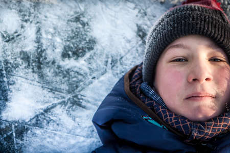 only one boy: Child portrait on winter background