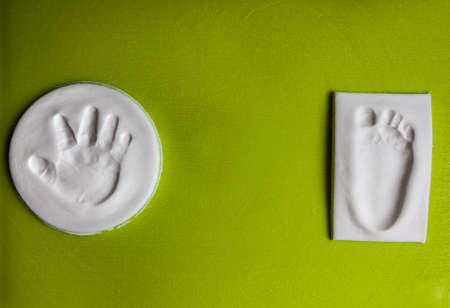 baby hand: Baby handprint and footprint with copy space. New life concept