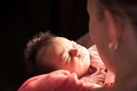 Newborn baby on mother hands Imagens