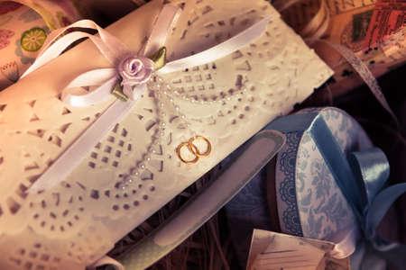 git: Vintage wedding invitation envelope with ribbon among git boxes Stock Photo
