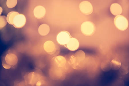 Toned bokeh with blinking Christmas lights in vintage style Imagens