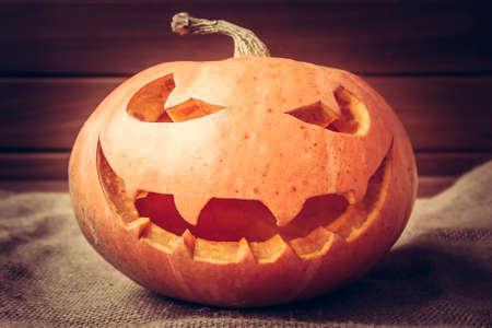 frightful: halloween pumpkin portrait on dark background