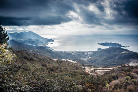 Mountains landscape on sea coast  with dramatic sky in overcast day in Europe country Montenegro