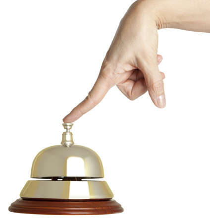 hospitality industry: Hand of a woman using a hotel bell  isolated