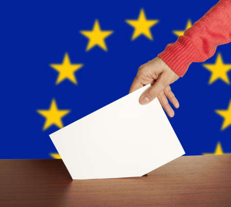 ec: Hand with ballot and box isolated on Flag of Europe Stock Photo